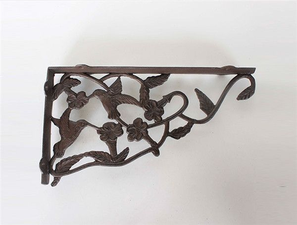 Cast Corner Shelf with birds