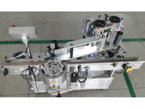 Round bottle positioning labeling machine