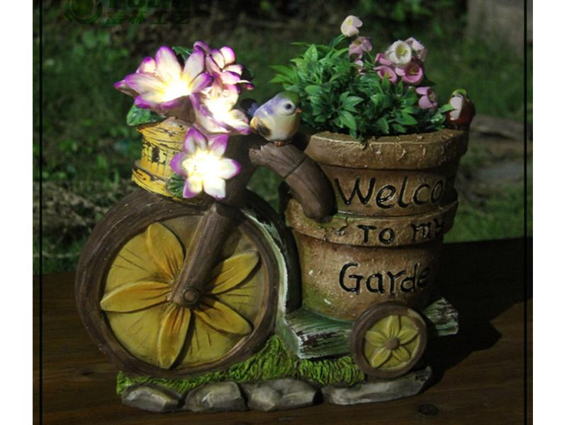 solar powered resin garden statue flower pott