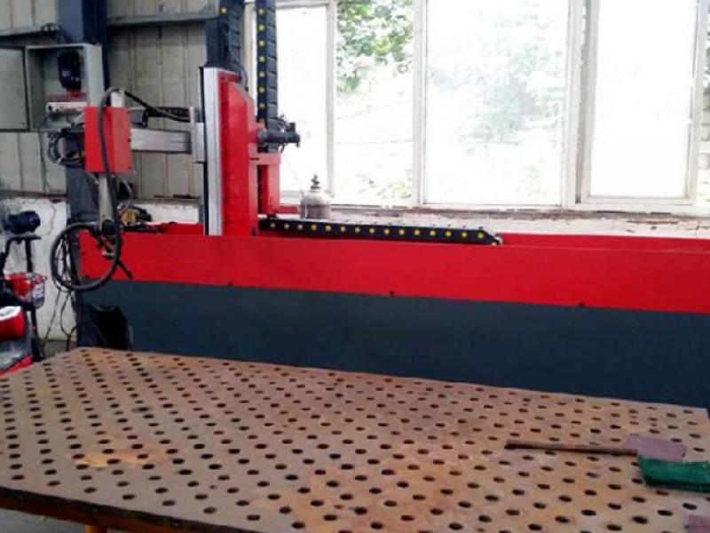 Automatic welding arm